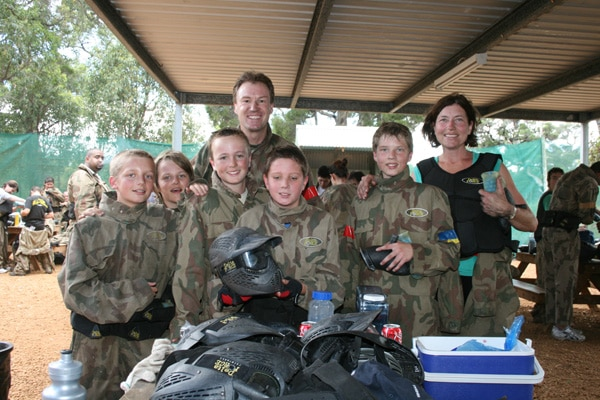 Mum, dad and the boys playing Delta Force Paintball